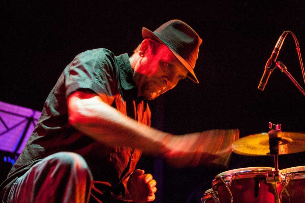 Gabe Harris performing on bongos