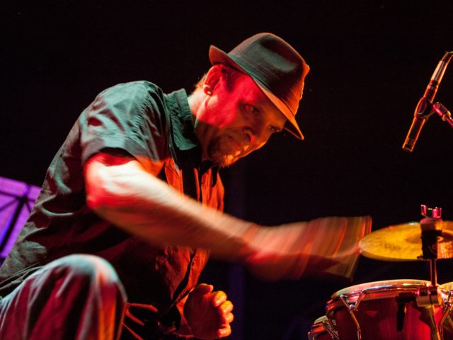 Gabe Harris performing on bongos